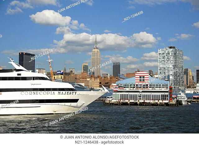 View from the Hudson River. The Empire State Building is in the center  and Pier 60 –part of the Sports and Entertainment Center- is in the foreground