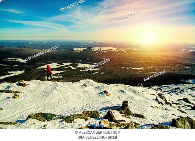 Man hiking on mountain in winter
