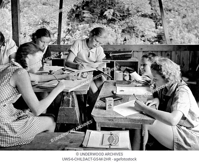 United States: c. 1929. An art class in a Girl Scout Sylvan Camp
