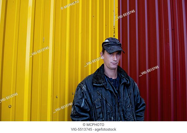 Trucker portrait Lithuania improvements industry farming with colorful company of wheat farming storage area with trucks in Vaunas Lithuania - 01/10/2015