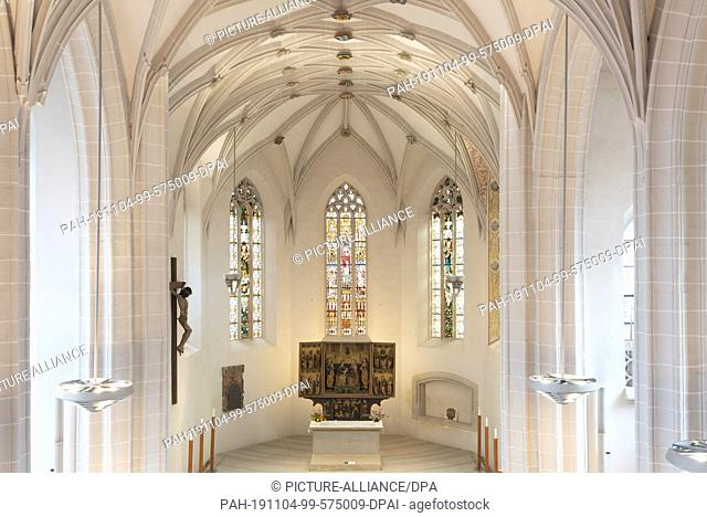 24 October 2019, Saxony-Anhalt, Eisleben: The late gothic hall church St. Petri and Pauli in Eisleben. It contains a baptismal font in which Martin Luther was...