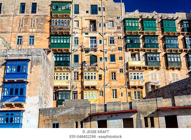 Historic architecture featuring interesting windows in medieval Valletta, Malta