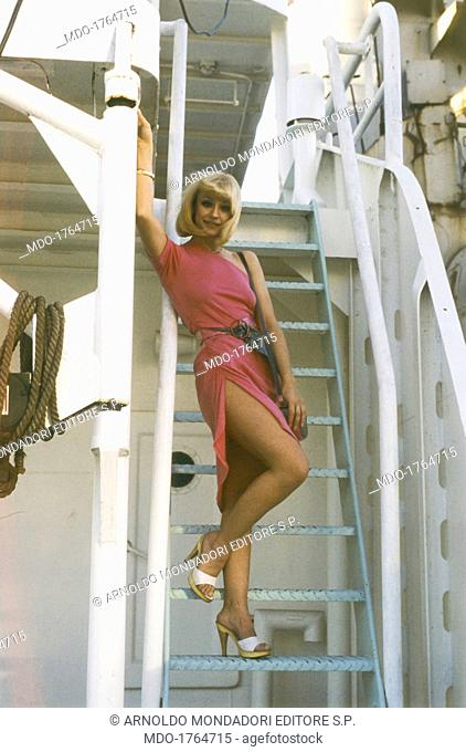 Raffaella Carrà in the film Barbara. Italian showgirl Raffaella Carrà (Raffaella Maria Roberta Pelloni) posing on the stairs of a ship in the film Barbara