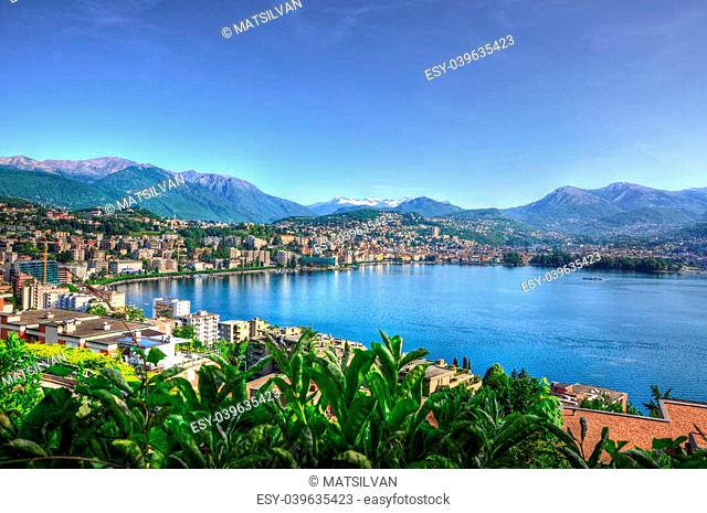 Cityscape with lake and mountain