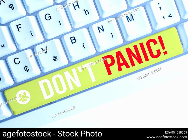 Word writing text Don T Panic. Business photo showcasing suddenly feel so worried or frightened that you can not behave White pc keyboard with empty note paper...