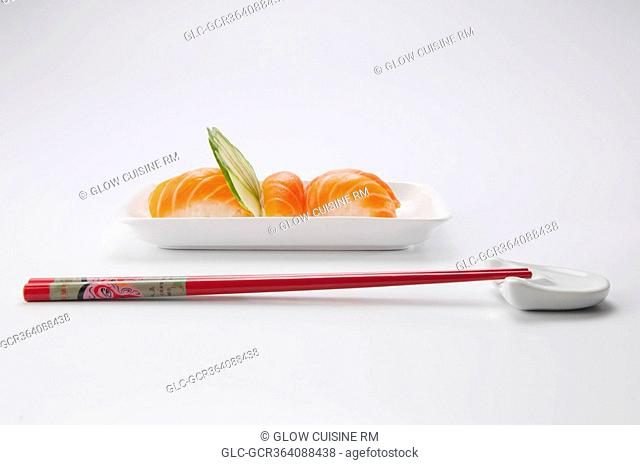 Close-up of sushi with chopsticks
