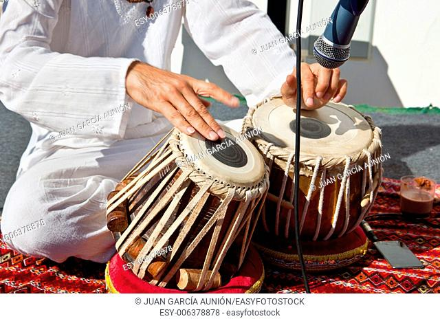 Man playing on traditional indian tabla drums. Closeup view