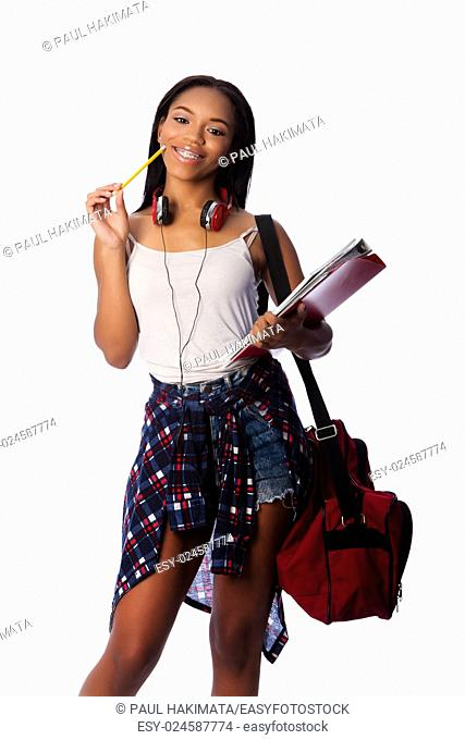 Beautiful happy smiling student standing thinking with pencil and notepad binders coming up with ideas, on white