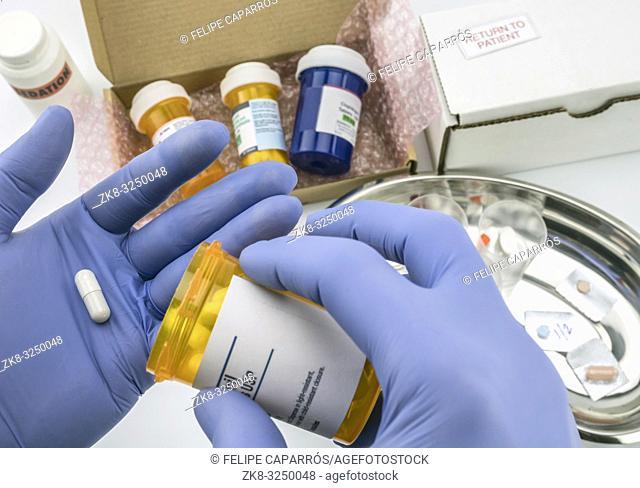 Nurse preparing hospital medication, conceptual image, horizontal composition