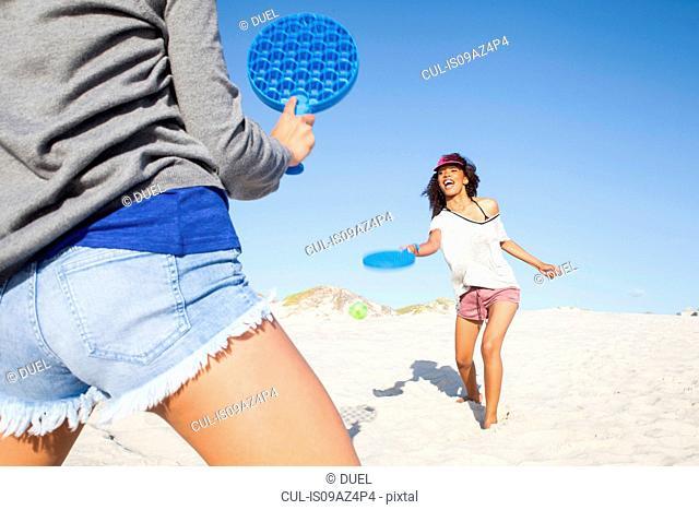 Women on beach playing tennis