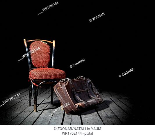 Red chair and suitcase