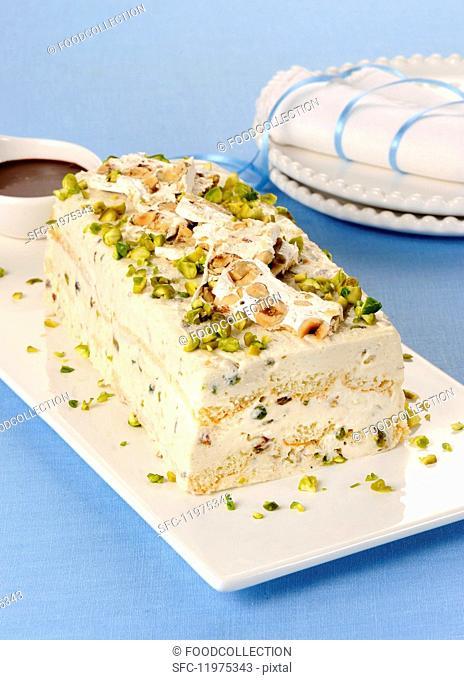 Semifreddo con spuma di torrone allo spumante (nougat moose ice cream with champagne sponge fingers, Italy)