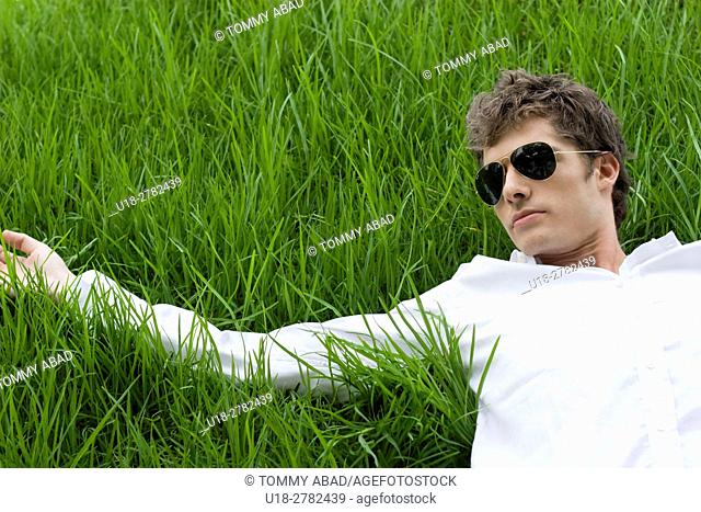 man laying down on the grass