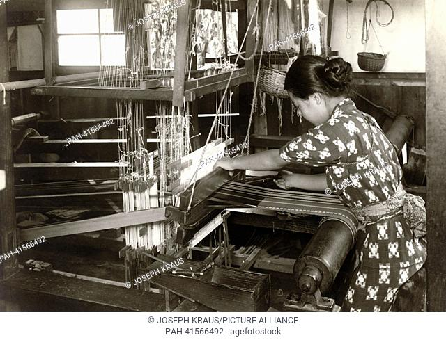 Woman working at the weaving loom. Pictured in the early 1920th. - /Japan