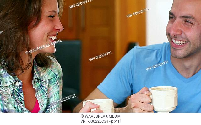 Student couple chatting together in the canteen