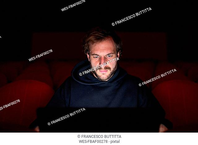 Portrait of director sitting at