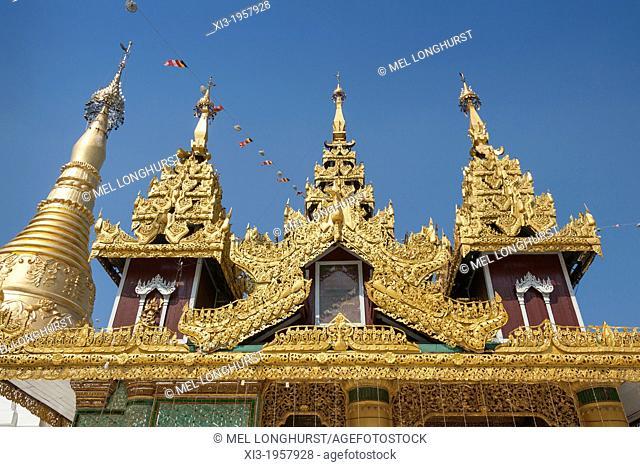 Ornate roof of a building and a stupa at Shwedagon Pagoda, Yangon, (Rangoon), Myanmar, (Burma)
