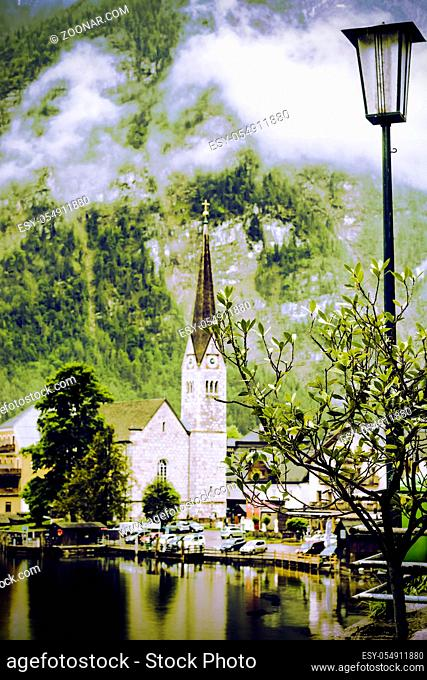 Neo-Gothic Evangelical Church located directly in the centre of Hallstatt in Austria. Rain, morning mist and clouds over the Austrian medieval small city