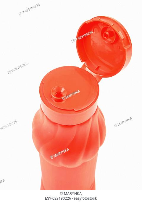 Red plastic bottle for ketchup sauce isolated on white background