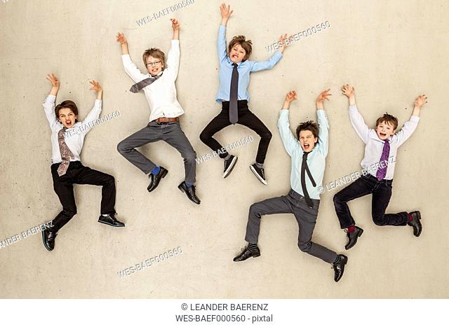 Business boys flying in office