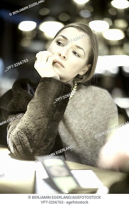 noble woman in restaurant, in Munich, Germany