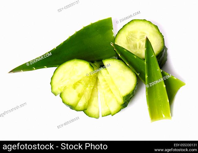 Green cucumber with aloe on a white background