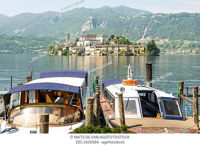 Taxi boats and island San Giulio on lake Orta in Piedmont, Italy