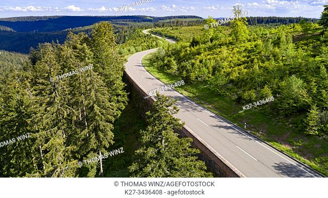 Curving highway through a forest in springtime from above. Black forest region, Germany