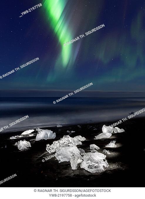 Aurora Borealis and Icebergs on the black sands, Breidamerkursandur, Iceland