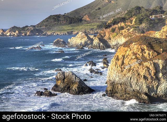 Waves crash along the rocky coastline south of Big Sur, California
