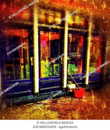 Mop, bucket and cleaning liquids outside prostitutes cabins, red light district (De Wallen), Amsterdam, Netherlands