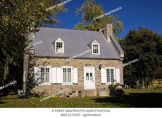 Simon-Lacombe (1825-1848) fieldstone House in Notre-Dame-des-Neiges cemetery on Mount Royal in autumn, Montreal, Quebec, Canada