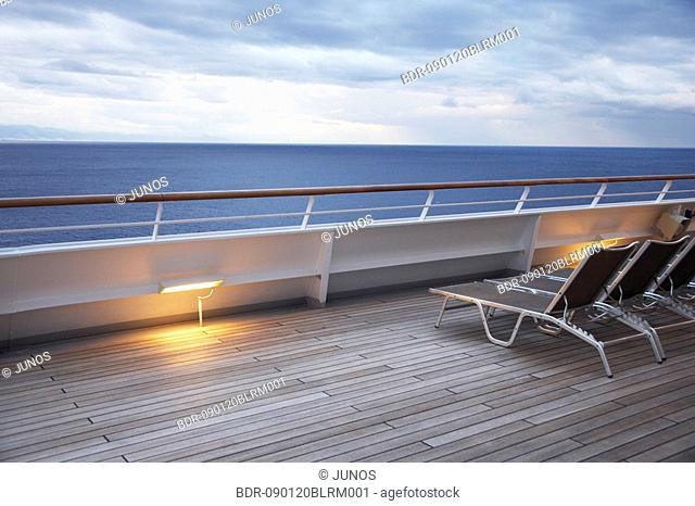 sunloungers on deck of cruise ship