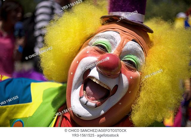 A clown laughs during the 16th International Clown Convention: The Laughter Fair organized by the Latino Clown Brotherhood, in Mexico City, October 17, 2011