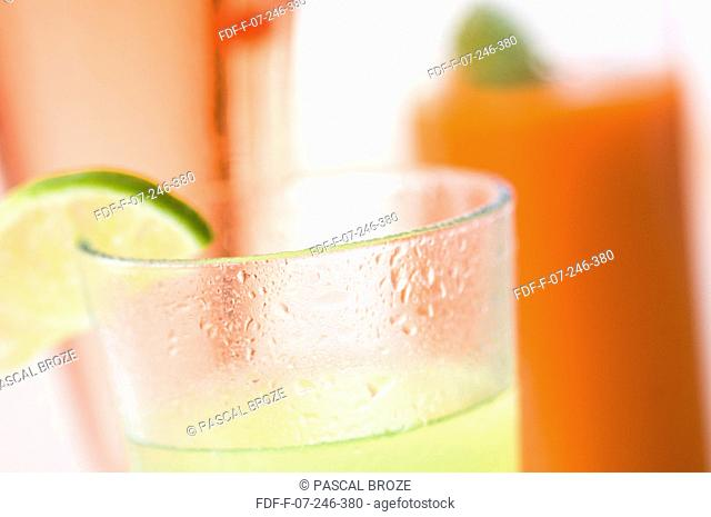 Close-up of glasses of carrot and gooseberry juice with lemonade