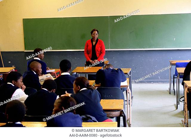 School teacher in front of classroom, St Mark's School, Mbabane, Hhohho, Kingdom of Swaziland