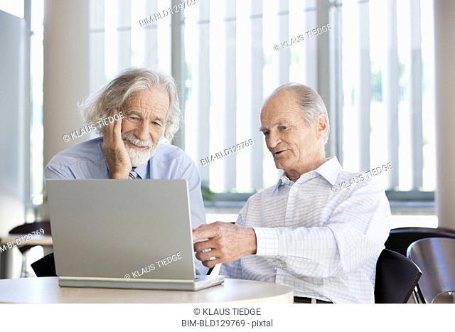 Senior Caucasian businessmen working together in office