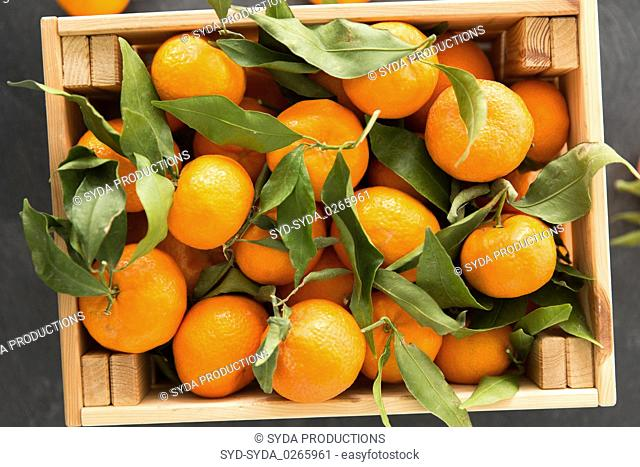 close up of mandarins on slate table top