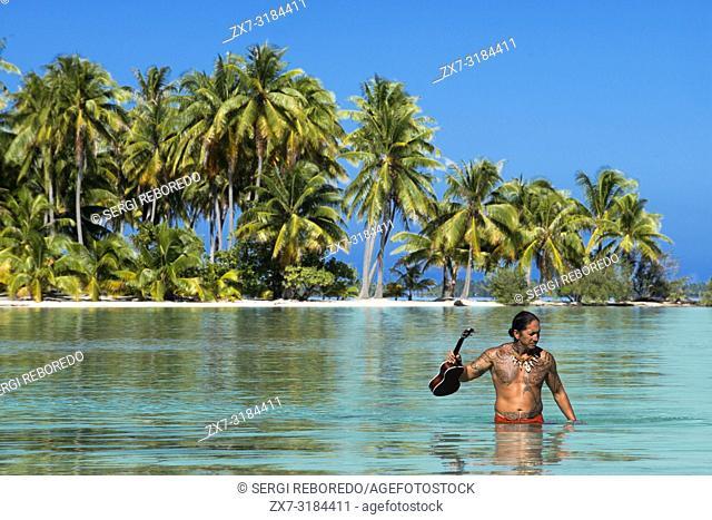 Island of Taha'a, French Polynesia. A local boy with the ukulele at the Motu Mahana, Taha'a, Society Islands, French Polynesia, South Pacific