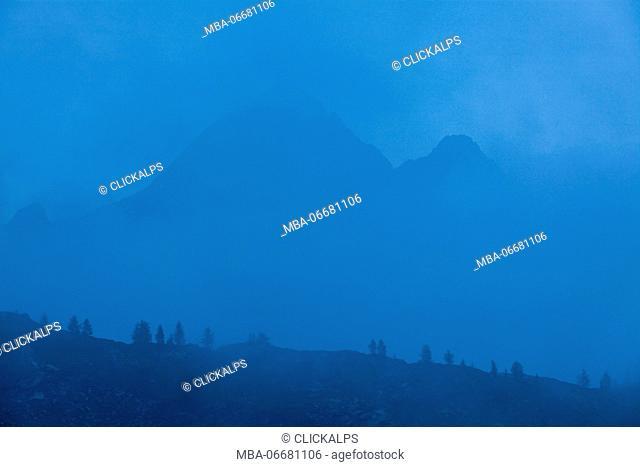 Carona, Brembana valley, Bergamo province, Lombardy, Italy. The Diavolo of Tenda and the Diavolino at blue hour view from Calvi refuge