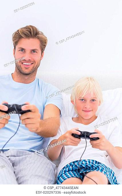 Happy father and son playing video games