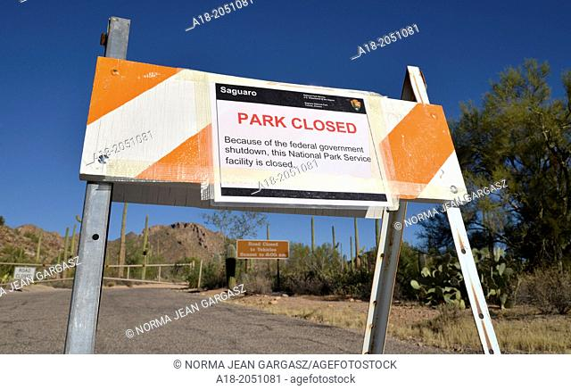 Signs at Saguaro National Park West in Tucson, Arizona, USA, indicate that the park is closed during the United States federal government shutdown effective on...
