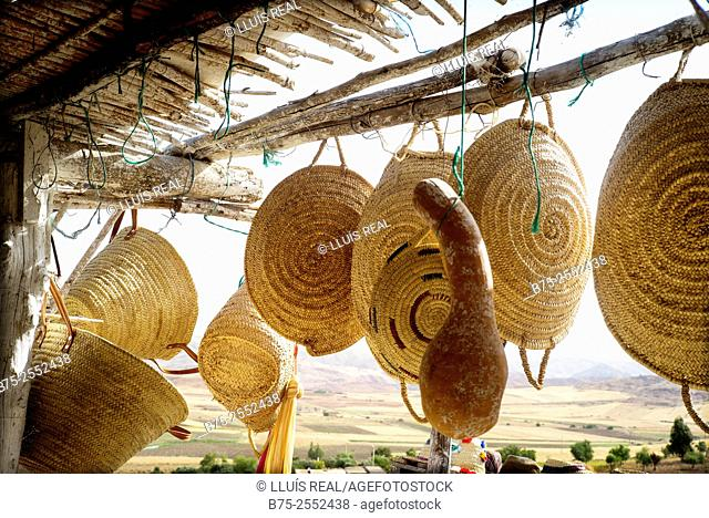 Typical straw baskets from Morocco in a stall of the road. Morocco, Africa