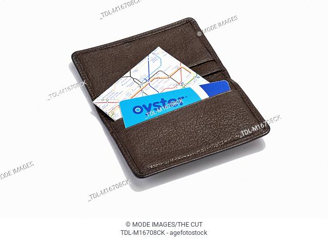 An Oyster card and tube map in a leather card holder