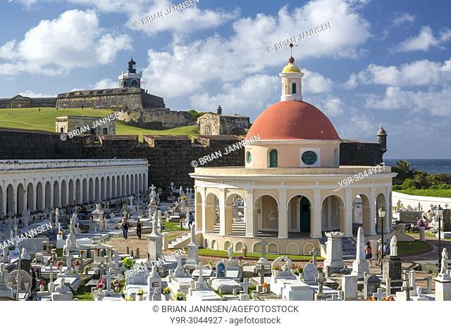 El Morro Fort stands guard over historic Santa Maria Magdalena de Pazzis Cemetery in old San Juan Puerto Rico