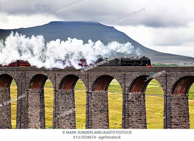 Steam Train Hauled by The Scots Guardsman on the Ribblehead Viaduct with Ingleborough Behind Yorkshire Dales England