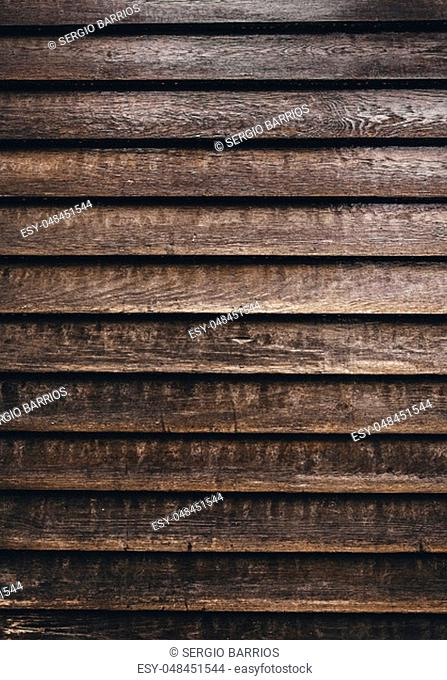 Old wood with rusty screws, detail of the passage of time, abandonment