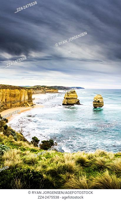 Panoramic view from Port Campbell National Park lookout towards 2 apostles during a stormy day. Australian natural wonders