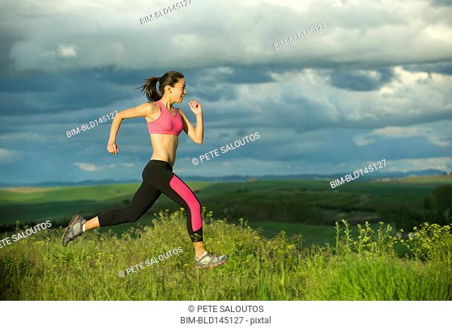 Japanese woman running in field