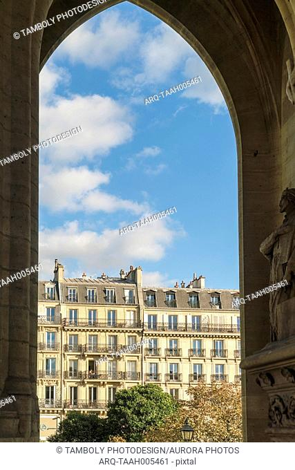 Exterior of historic buildings under blue sky with clouds at square of St Jacques, Paris, France